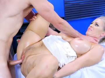 Mature blonde Julia Ann spreads her shaved pussy in missionary position